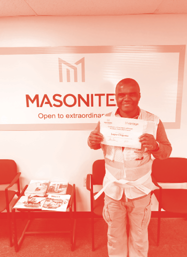 Masonite associate receives Certificate of Completion of Kaizen Facilitator Yellow Belt Course.